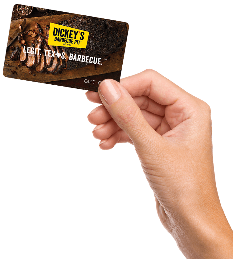 Hand holding Dickey's gift card.